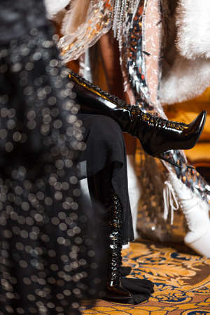 Shiny show girls with crazy black and white leather and feather outfits with crystals in Eastern Europe Latvia Riga corporate event