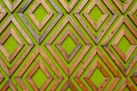 Pattern of wooden planks, rhombuses nailed to plywood painted green. Foto de archivo