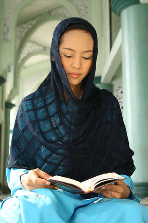 jilbab: Muslim Girl Realding Quran Stock Photo