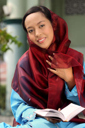 jilbab: Muslim Girl Holding Koran