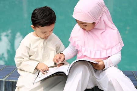 kids reading: Muslim Kids Reading a Book