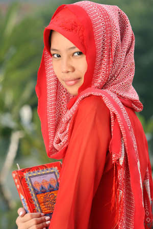 jilbab: Muslim Girl Holding Quran