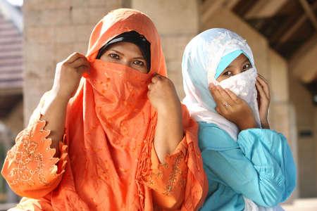 cowering: Muslim Females Cowering Faces   Stock Photo