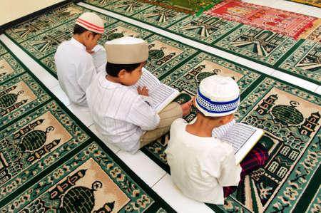 Kids Reading Koran photo
