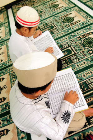 Kids Reading Koran photo