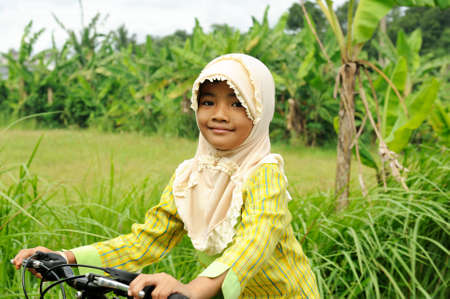 Muslim Girl Riding Bicycle photo