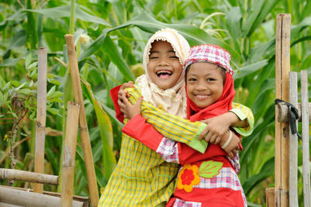 indonesia girl: Playful kids Stock Photo