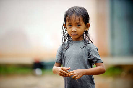 Poverty child in a rain