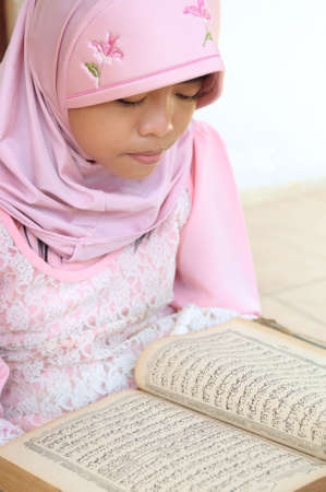Muslim Girl Reading Koran photo