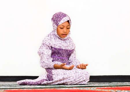 Muslim girl praying at the Mosque photo
