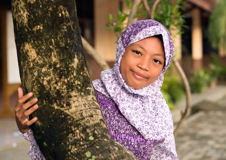 Outdoor portrait of young Muslim girl