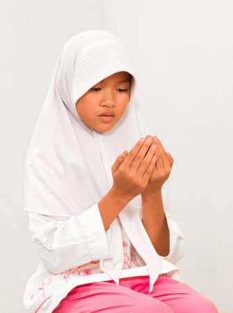 Muslim Little girl praying photo