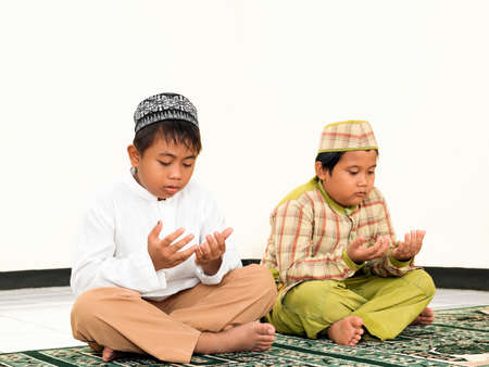 Muslim kids praying at school photo