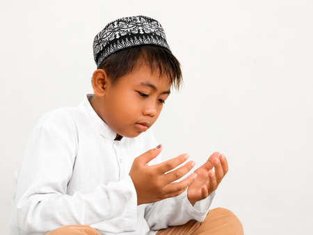Muslim child praying at Islamic school Stock Photo - 13103165
