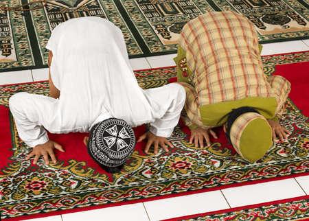 Muslim children praying in Mosque photo