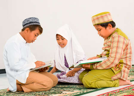 Muslim children reading Holy Koran photo