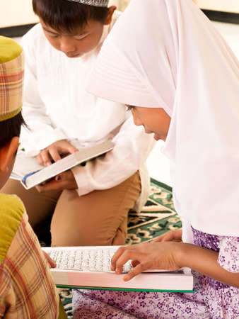 Muslim kids reading Koran at Islamic School