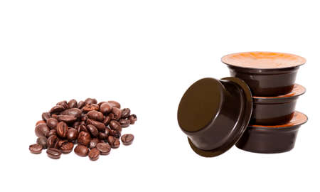 expressed: heap of coffee grains and four coffee capsules Stock Photo