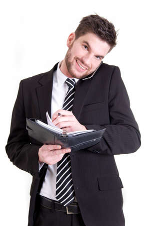 coordinating: A smiling business man coordinating his appointments  Stock Photo