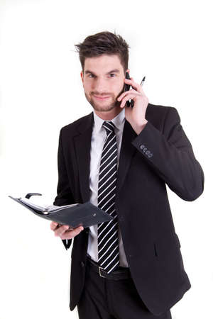 coordinating: A business man coordinating his appointments Stock Photo