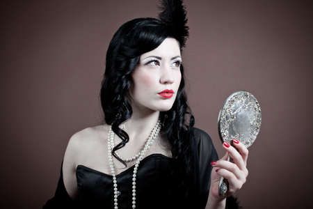 Beautiful woman with a hand mirror   vintage