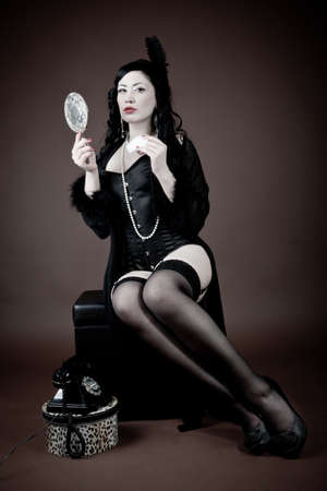 Beautiful woman in lingerie with hand mirror  vintage  Stock Photo