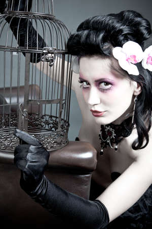 Gothic Woman with a empty birdcage  photo