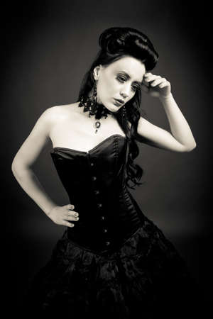 burlesque: Gothic woman lost in thoughts Stock Photo
