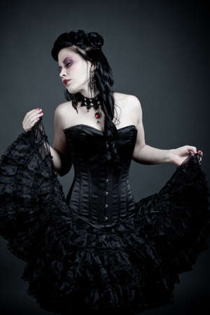 Gothic woman dancing lost in thoughts  photo