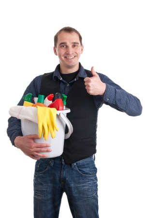 role reversal: Smiling man with a bucket full of cleaning products and thumb up