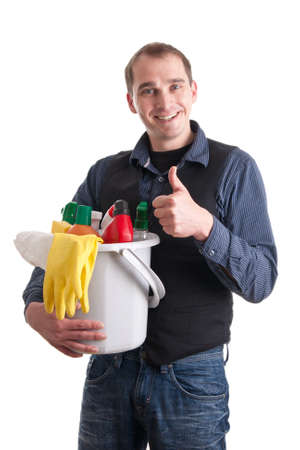 Smiling man with a bucket full of cleaning products and thumb up  photo