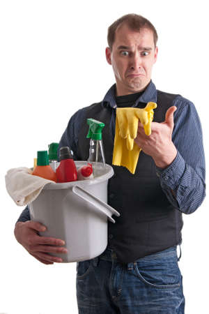 role reversal: Man gazes helpless to the cleaning products and gloves