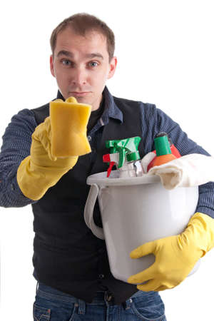 ��role reversal�: Man with a bucket full of cleaning products and a sponge try to clean