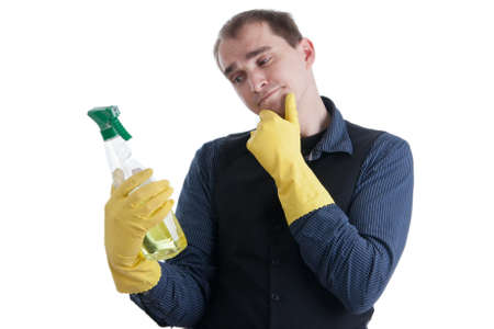 cleaning products: Man thinking about the use of a aerosol can