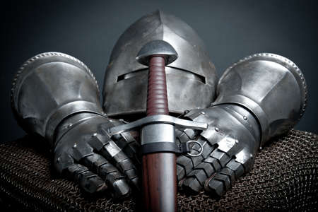 armor: Knights armor with helmet, chain mail, gloves and sword  Stock Photo