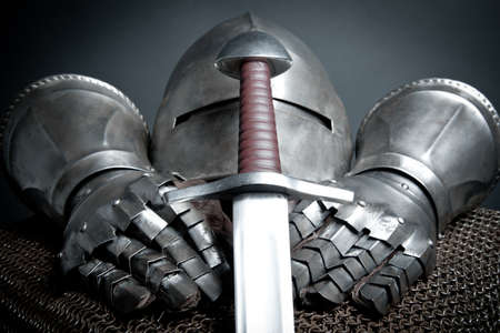 chain armour: Knights armor with helmet, chain mail, gloves and sword  Stock Photo