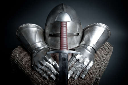 ancient warrior: Knights armor with helmet, chain mail, gloves and sword  Stock Photo