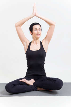 Woman making yoga Stock Photo