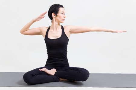 Woman making yoga Stock Photo