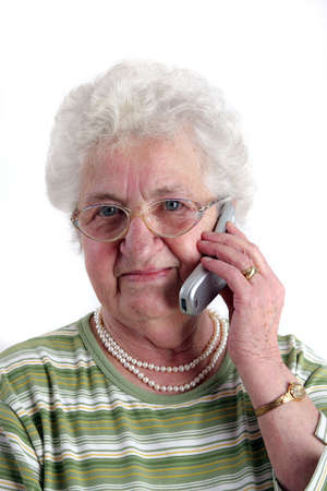 A old woman using a mobile phone  Stock Photo