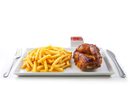 Grilled roasted half chicken with chips and ketchup - German Fast Food Stock Photo - 16316460