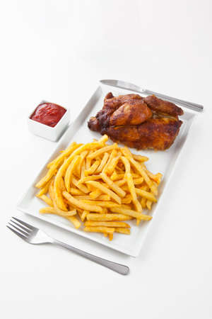 Grilled roasted half chicken with chips and ketchup - German Fast Food  Stock Photo - 16316463
