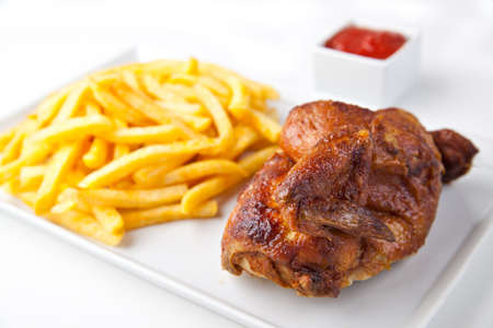 grilled chicken: Grilled roasted half chicken with chips and ketchup - German Fast Food