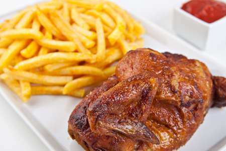 Grilled roasted half chicken with chips and ketchup - German Fast Food  photo
