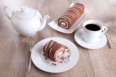 Chocolate roll with a cup of coffee and a pot Stock Photo - 16480841