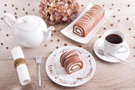 Chocolate roll with a cup of coffee and a pot Stock Photo - 16480843