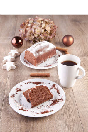 Christmas cake with a cup of coffee  photo