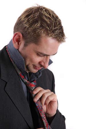 hait: Businessman folding his tie