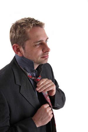 bind: Businessman bind his necktie