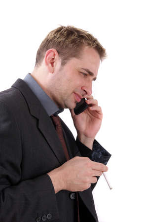 hait: Man in suit with cigarette and mobile phone  Stock Photo